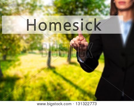 Homesick - Businesswoman Hand Pressing Button On Touch Screen Interface.