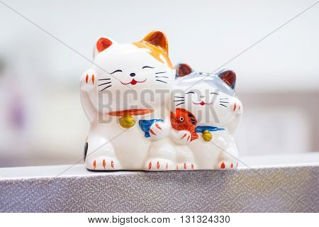 Twin Cats Ceramic Model with Blur Background