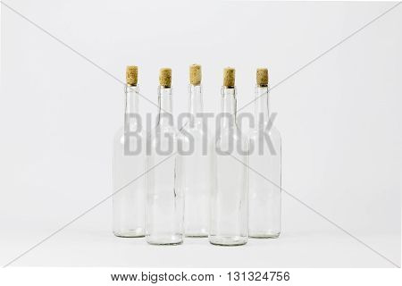 Group of empty glass bottle with cork isolated on white background