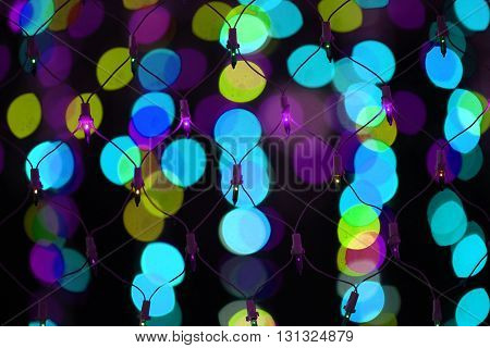 A wire mesh of colorful decoration light on the backdrop of other colorful lights
