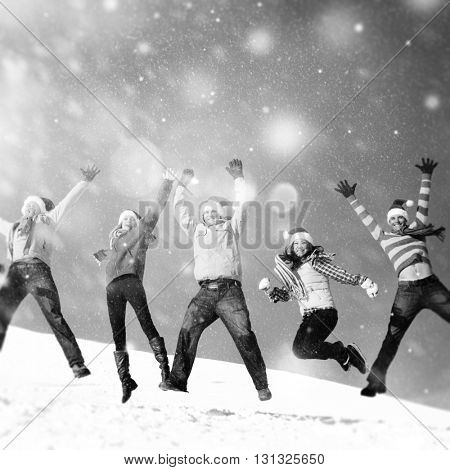 Jumping in The Snow Friends Happiness Concept