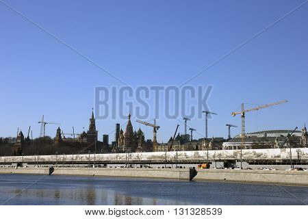 panorama of many tower cranes and St Basils Cathedral and Cremlin - the eternal construction in modern Moscow