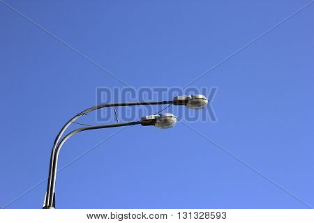 double head of steel streetlight closeup on blue sky background Moscow Russia