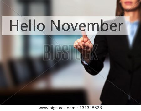 Hello November - Businesswoman Hand Pressing Button On Touch Screen Interface.