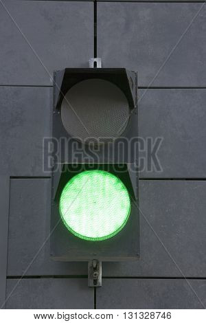 green traffic lights near entrance to underground parking Moscow Russia