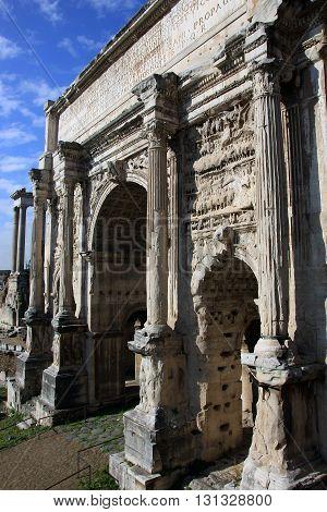 ancient roman marble triumphal arch of Septimius Severus (Arco di Settimio Severo) in Roman Forum Rome Italy