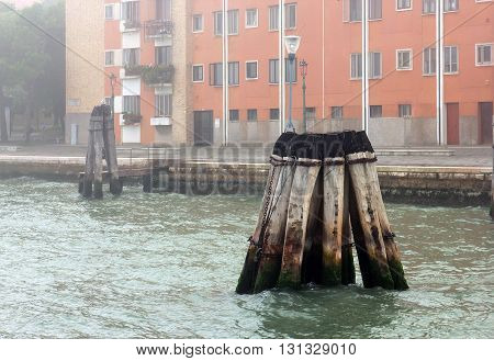wooden pillars in the Adriatic sea near Venice Italy
