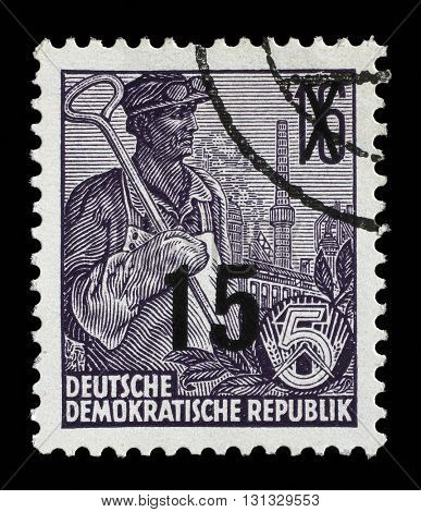 ZAGREB, CROATIA - SEPTEMBER 05: A stamp printed in GDR, shows a worker, series Five-year plan, circa 1955, on September 05, 2014, Zagreb, Croatia
