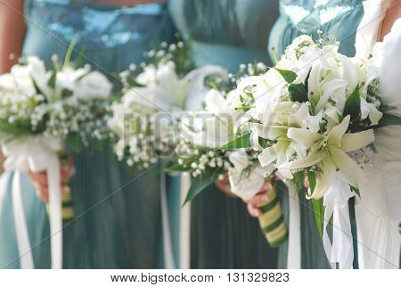 bouquet with hands holding in wedding celebration soft tone with selective focus