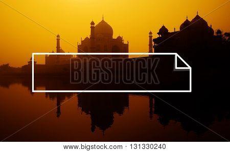 Sunset silhouette of a grand Taj Mahal.