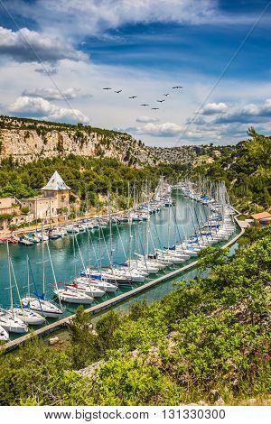 Small fjords between Marseille and Cassis in Calanque National Park. White sailboats moored in rows near the shore