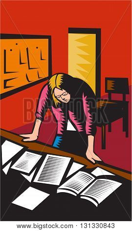 Illustration of a teacher in a classroom depressed looking down with both hands on desk with books notes papers on it with board and chairs in the background done in retro woodcut style.