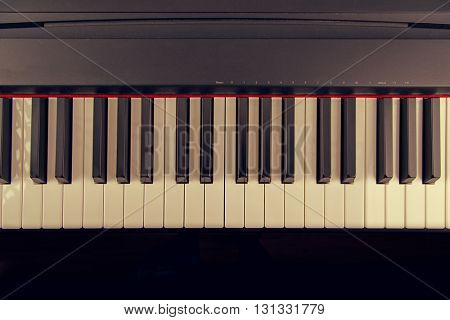 Electronic musical keyboard, close-up.