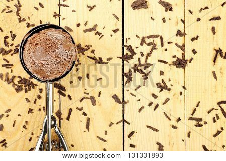 ice cream scoop on wood with chocolate bits