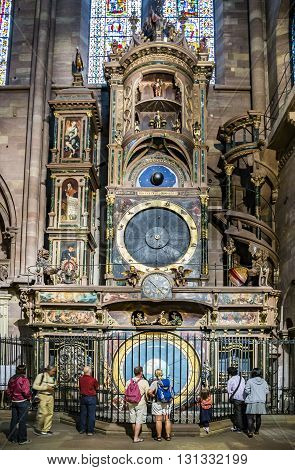 People Visit The Clock In The Cathedral Of Strasbourg
