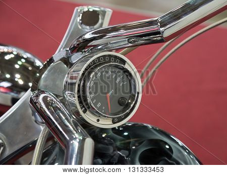 Part of steering handle and motorcycle speedometer close up