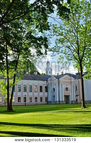 Novgorod Kremlin park with Clock Tower of Sophia Cathedral framed by trees in Veliky Novgorod Russia. Architecture spring landscape