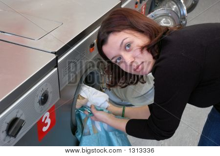 Young Woman Doing The Laundry