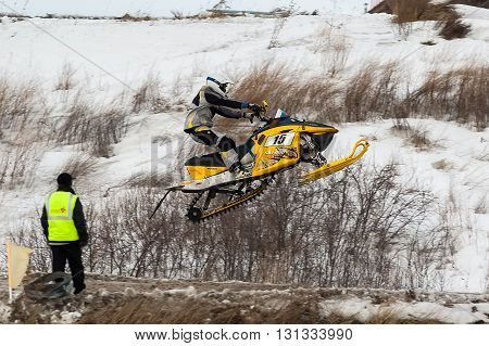 Tyumen, Russia - March 08. 2008: IV stage of personal-team Championship of Ural Federal district in over-snow cross-country. Flying of sportsman on snowmobile