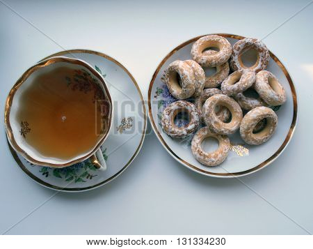 Bagels and tea Bread products choux pastry in the form of rings of different sizes. Homeland bagels Belarus. Bagels served with tea.
