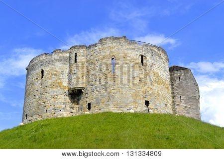 York Yorkshire England UK - May 22 2016 : The historical York Castle in the city of York commonly referred to as Clifford's Tower.
