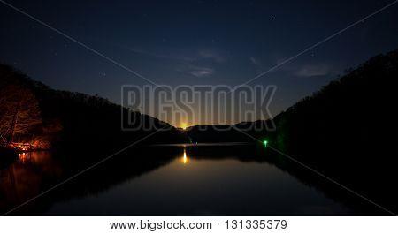 Night fishing under a rising full moon. Taken at Cave Run Lake in Kentucky.