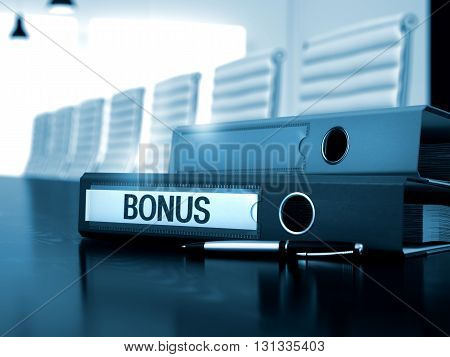 Office Binder with Inscription Bonus on Black Desk. Bonus - Illustration. Bonus - Business Concept on Blurred Background. 3D Render.