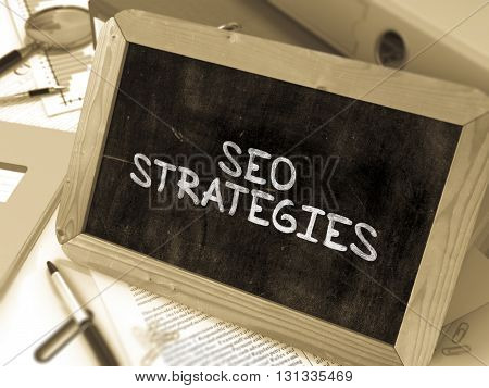 Hand Drawn SEO - Search Engine Optimization - Strategies Concept  on Chalkboard. Blurred Background. Toned Image. 3D Render.