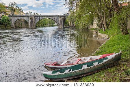 Boats in front of the roman bridge in Amarante Portugal