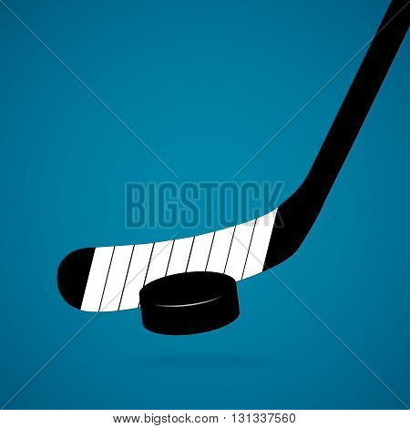 Hockey stick and puck isolated on a blue background