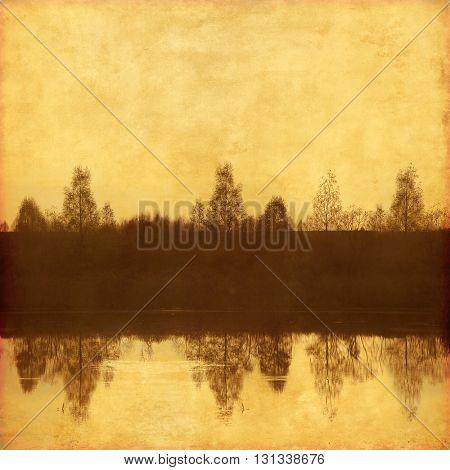 Grunge background with trees near lake.