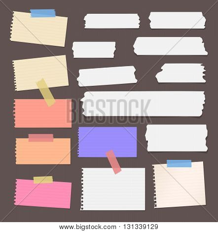 Colorful ripped lined blank note paper, sticky, adhesive tapes are stuck on brown wall.