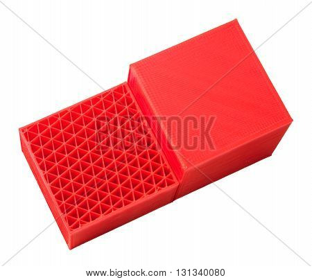 3d printed whole cube and half of cube showing internal triangles structure. red 3d printer pla filament. isolated on white. concept new home technology education. printing prototypes developing innovations. 3d printing industry. triangle inside