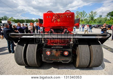 KIEV,UKRAINE - May,21: Red Pearl Scania R999 by Svempas Customs - customized racing truck, back view at the celebration of 125 th anniversary Scania in Kiev,Ukraine May 21,2016.