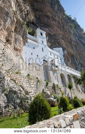OSTROG MONTENEGRO - SEPTEMBER 22 2015 : Pilgrims and other visitors in the Ostrog Monastery a Serbian Orthodox Monastery in Ostrog Montenegro
