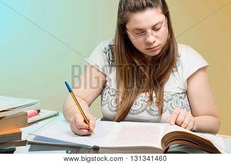 a girl studying with pen in hand