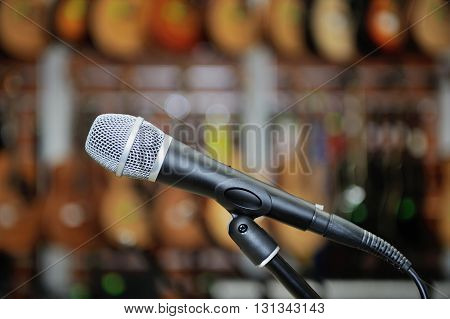 Microphone against the background of music shop