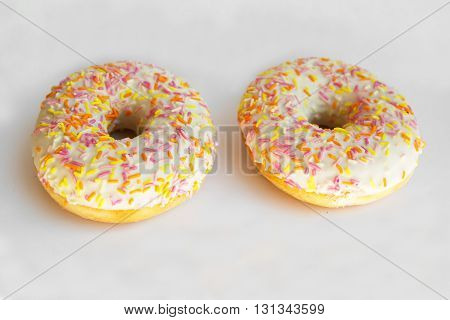 Donut with sugar caramel. Delicious sweet food. Pastries for the sweet tooth. Lush colored donuts.