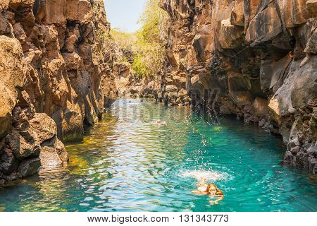 Puerto Ayora Galapagos Ecuador - April 2 2016: People are swimming in Las Grietas on Santa Cruz Island in Galapagos. It is popular tourist destination on Santa Cruz Island.