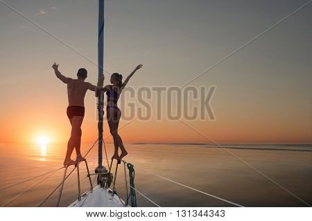 People standing on yacht railings. Man and woman on yacht. Unforgettable vacation at sea. Life is beautiful.