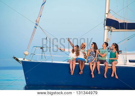 People take selfies on yacht. Girls and guys on boat. One more photograph. Send greetings to the relatives.