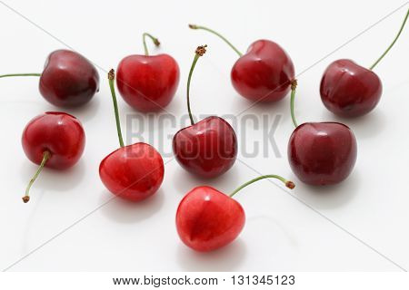 Cherry isolated on white background. Ripe red cherry berries. Sweet cherries.