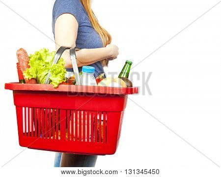 Basket with produce in woman hand