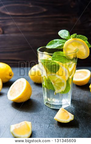 Refreshing cold lemonade Cocktail on dark stone table