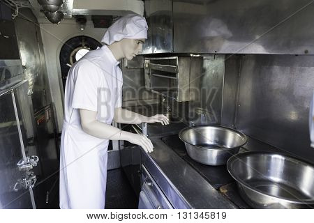 A male cook mannequin in a kitchen