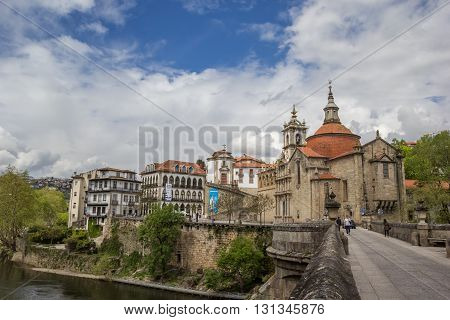 AMARANTE, PORTUGAL - APRIL 22, 2016: Roman bridge leading to historical town Amarante, Portugal