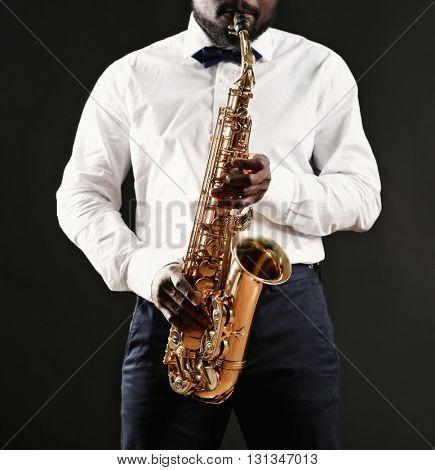 African American jazz musician playing the saxophone, closeup