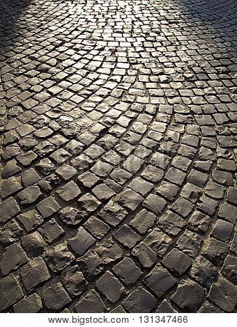 Cobble stone street background at sunset, Italy