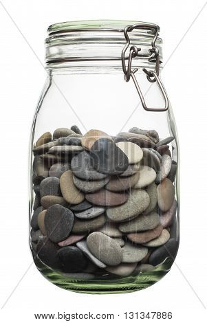 Pebble canned in a jar. Glass jar with sea pebbles isolated on white bacground.