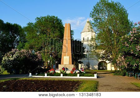 VELIKY NOVGOROD RUSSIA - MAY 24 2016. Gate tower of Yaroslav's courtyard and the monument to heroes of Great patriotic War at spring sunset